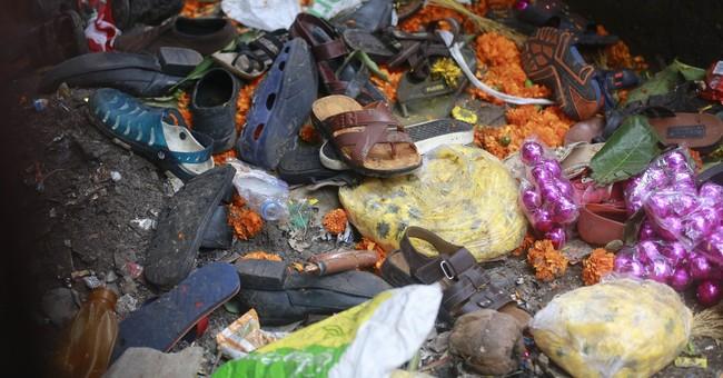 Stampede on crowded Indian pedestrian bridge leaves 22 dead
