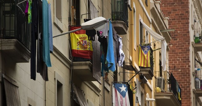 Speaking up isn't so easy for Catalans who also feel Spanish