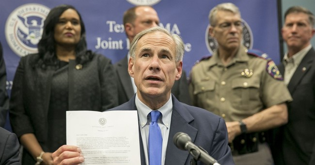 Texas governor gives Houston $50M for Harvey following clash