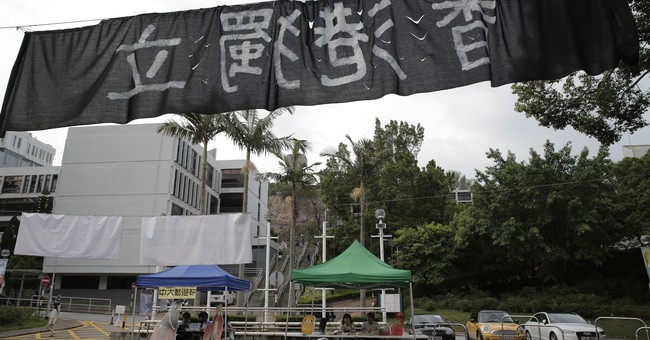 In Hong Kong, political banners reveal gulf with mainland