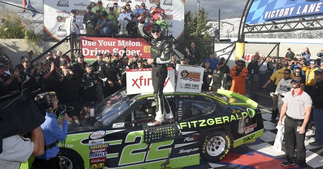 Cup star Blaney crashes Xfinity playoffs and wins at Dover