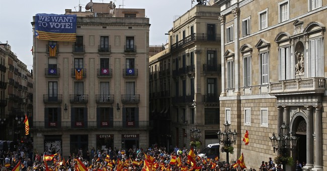 The Latest: Protesters rally against Catalan independence