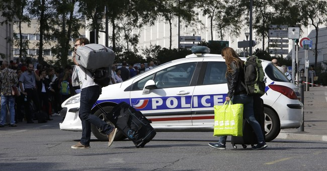 The Latest: IS claims responsibility for slayings in France