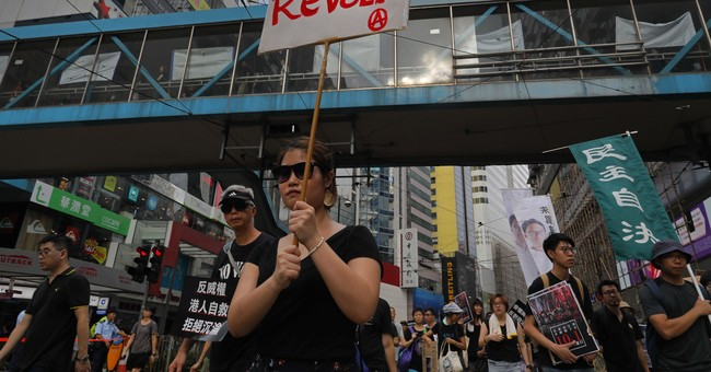 Thousands of pro-democracy supporters protest in Hong Kong