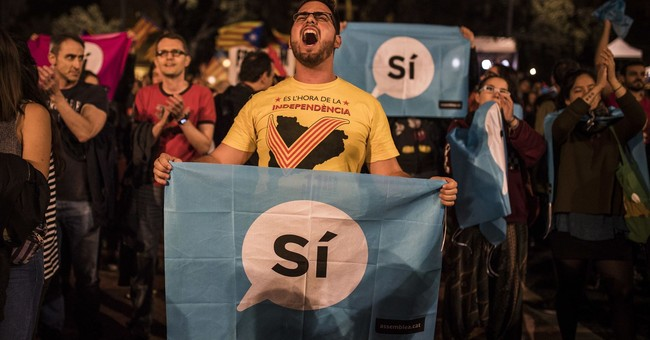 The Latest: Shares drop in Catalan banks after vote