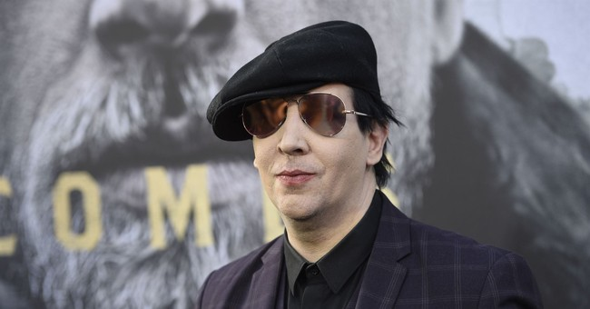 Marilyn Manson, hurt onstage in NY, cancels Oct. tour shows