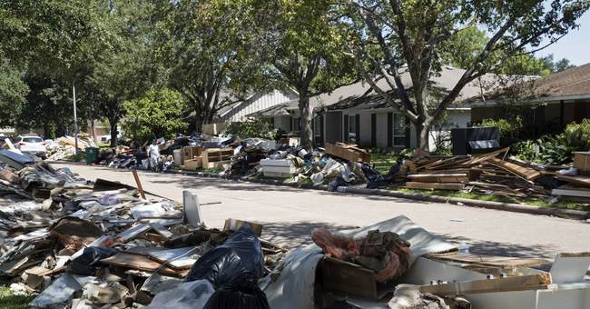 Month after Harvey, debris piles show recovery takes time