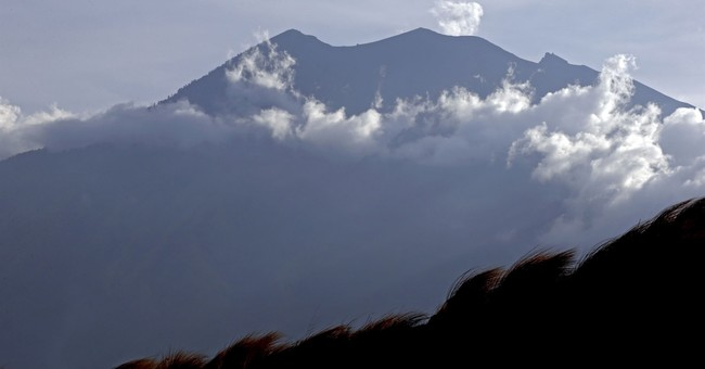 Tradition pulls some to Bali volcano, others refuse to leave