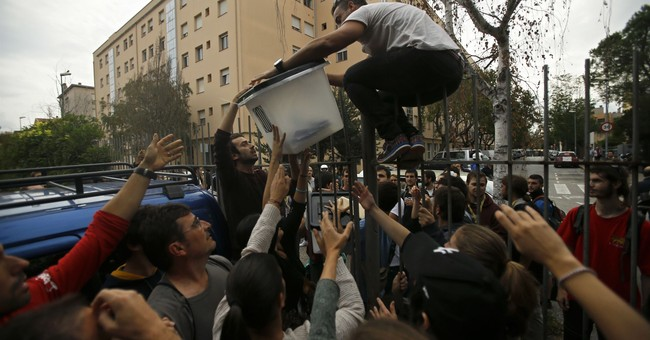AP PHOTOS: A chaotic 24 hours in Spain's Catalonia region