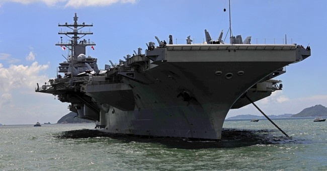 The Latest: US Navy admiral pledges to defend Japan, S.Korea