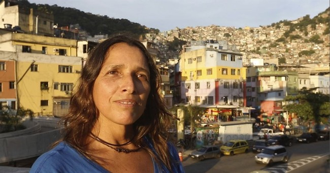 AP photographer reflects on 13 years covering Rio shootings