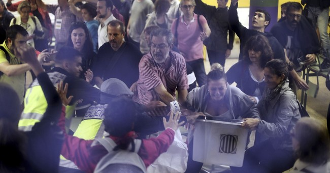 Analysis: Spanish police attacks_ mistake or part of a plan?