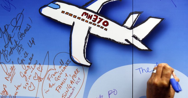 Report says mystery of Flight 370 is 'almost inconceivable'