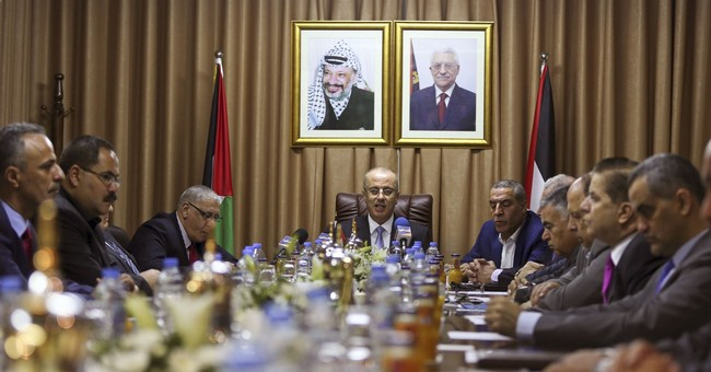 The Latest: Israel sets conditions for Hamas-Fatah deal