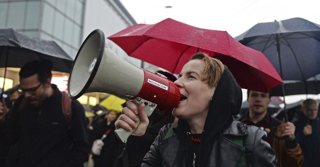 Polish women march again, year after large 'black protest'