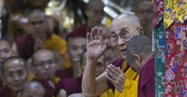 Image of Asia: Dalai Lama greets devotees