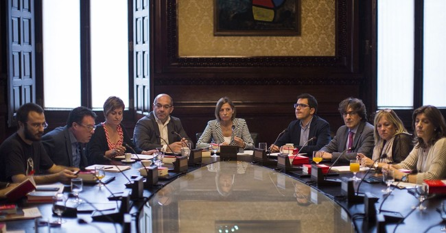 The Latest: Catalan advisers say parl't session is illegal
