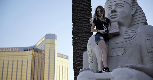After massacre, Las Vegas gets back to beers, slots, shows
