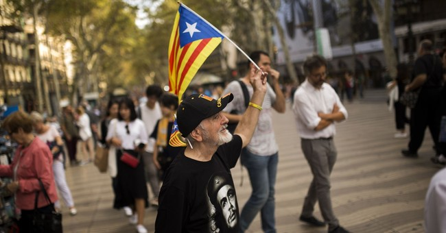 Catalan officials mull independence; Spanish stocks sink
