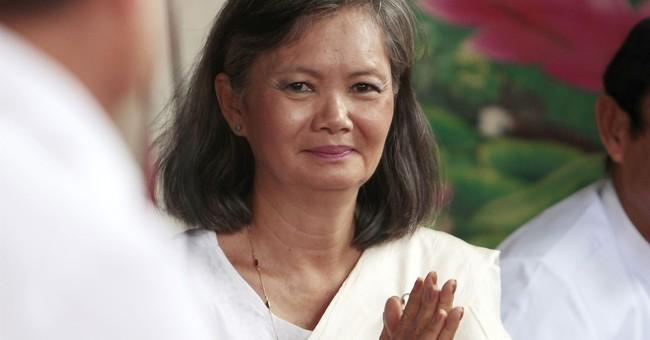 Cambodian opposition lawmaker flees after arrest warning