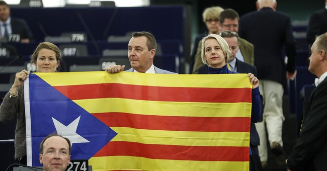 Top EU officials rally behind Spanish PM over Catalan poll