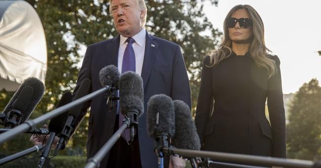 The Latest: Trump somber in visit to stricken Las Vegas