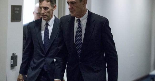 AP source: Man behind Trump dossier talks to investigators