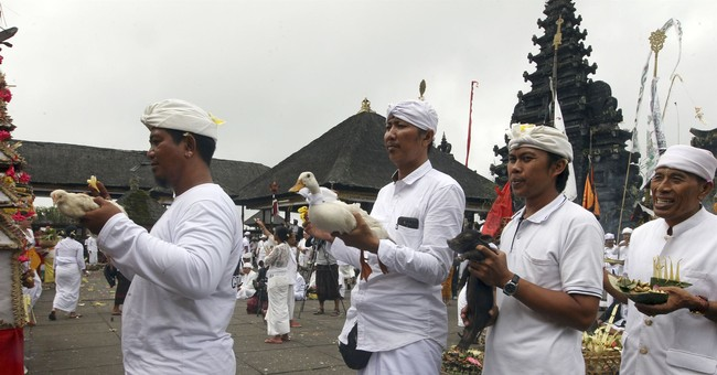 Dozens pray at Hindu temple on slopes of Bali volcano