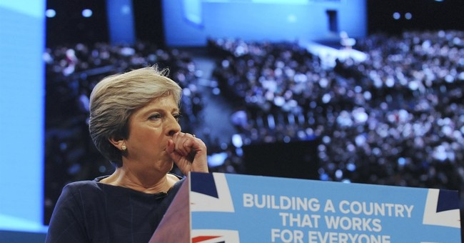 UK's May finds support after lawmakers plot to oust her