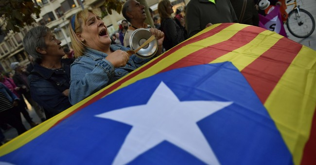The Latest: Spain minister warns of Catalan business exodus