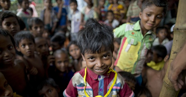 Unrecognized at home, Rohingya refugee receives 1st ID card