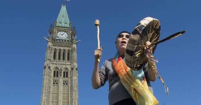 Canada pays indigenous people taken from their homes