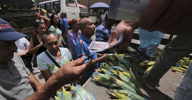 Ham for a watch: Venezuelans struggle with cash shortages