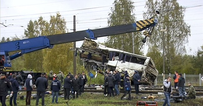 19 killed in Russia after train hits bus stuck on crossing
