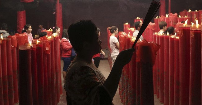 China marks Lunar New Year with prayers, incense, fireworks