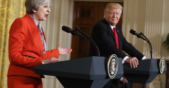 May's mission to woo Trump a success, but makes some uneasy