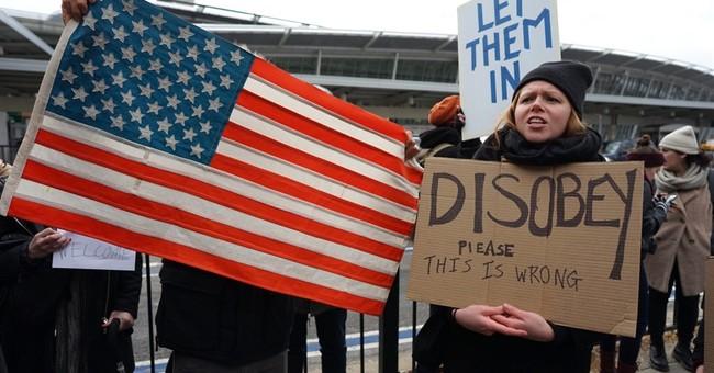 US judge bars deportations under Trump travel ban