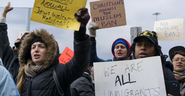 Despair, confusion reign as Trump's travel ban hits