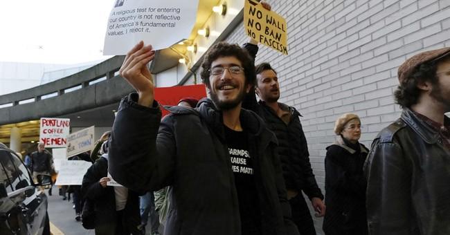 Protests erupt at airports following Trump travel ban