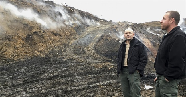 Underground fires, toxins in unfunded cleanup of old mines