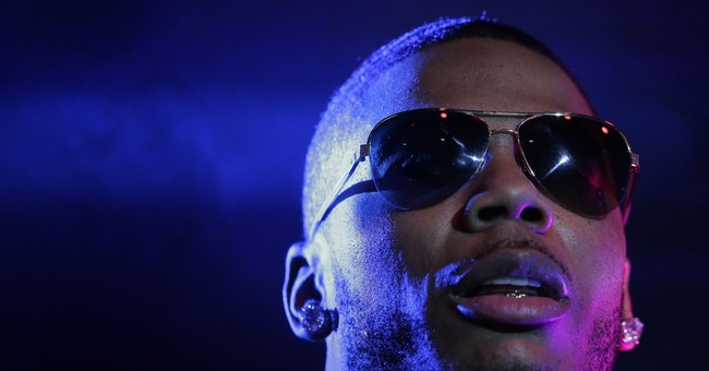 The Latest: Rapper Nelly released from jail after arrest