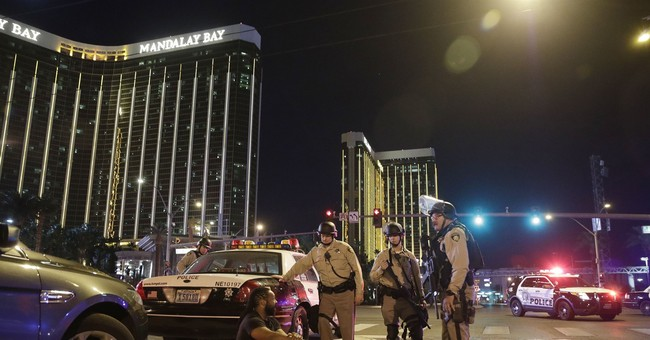 The Latest: Vegas dims lights to mark week since shooting