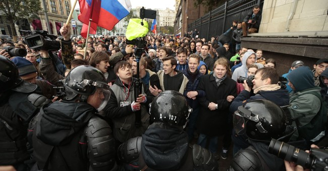 Protesters rally across Russia on Putin's 65th birthday