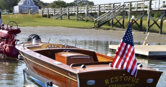 The Latest: Boat that belonged to Kennedy sells for $75,000