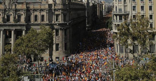 The Latest: Huge crowds rally against Catalan secession