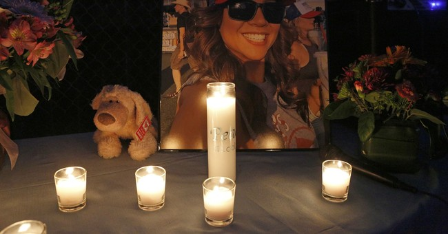 The Latest: Vigil held to remember woman with huge heart