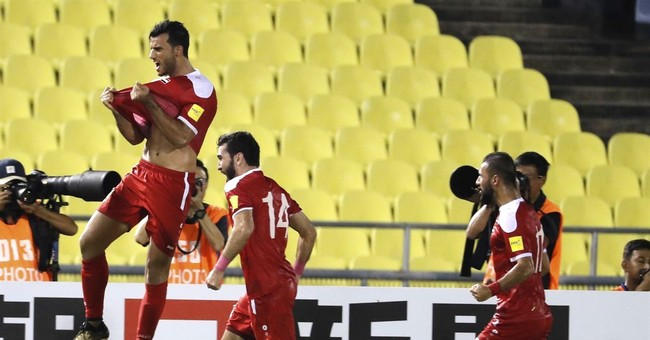 Australia aims to halt Syria's World Cup charge in Sydney