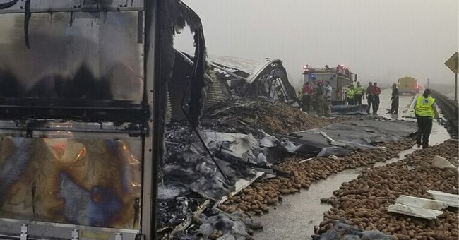 Fiery tractor-trailer wreck kills driver, scatters potatoes