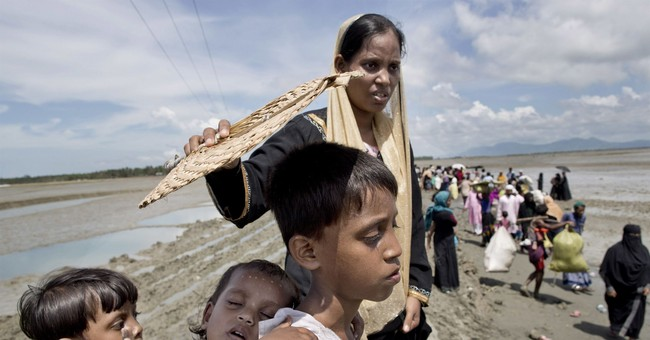 AP PHOTOS: A Rohingya boy's struggle to reach Bangladesh