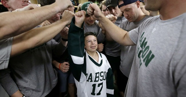 Chronically ill 4th-grader signs with college hockey team